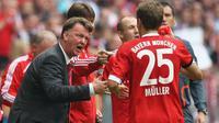 KAGUM - Thomas Muller mengaku kagum dengan ketegasan dan kedisiplinan pelatih Manchester United, Louis van Gaal. (Daily Mail)