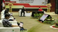 Ketua Dewan Komisioner OJK Wimboh Santoso melakukan pertemuan dengan Gubernur Bali I Wayan Koster