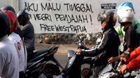Coretan vandalisme menyuarakan kemerdekaan Papua Barat marak di Solo. (Solopos.com/ Nicolous Irawan)