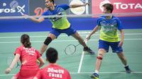 Ganda campuran China, Zheng Siwei/Huang Yaqiong, mengaku tak melakukan persiapan khusus untuk laga final Indonesia Masters 2019 melawan Tontowi Ahmad/Liliyana Natsir. (AFP/Claus Fisker)