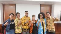 Sekelompok pemuda yang tergabung dalam Papua Muda Inspiratif usai bertemu Jokowi di Istana, Senin (14/10/2019). (Ist)