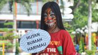 Aksi kampanye memperingati Global Tiger Day di Lapangan Merdeka, Medan, Sumatera Utara, Minggu (9/8/2015). (Liputan6.com/Reza Perdana)