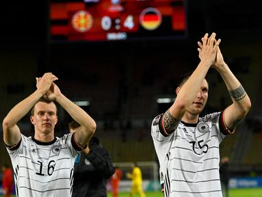 Timnas Jerman menjadi tim pertama selain tuan rumah Qatar yang memastikan lolos ke Putaran Final Piala Dunia 2022. Hasil itu didapat usai Tim Panser menang telak 4-0 atas tuan rumah Makedonia Utara dalam laga Kualifikasi Zona Eropa Grup J, Minggu (11/10/2021). (AFP/Nikolay Doychinov)