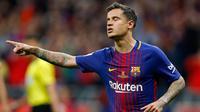 Gelandang Barcelona, Philippe Coutinho melakukan selebrasi usai mencetak gol ke gawang Sevilla di final Copa del Rey di stadion Wanda Metropolitano di Madrid (21/4). Barcelona menang 5-0.  (AP Photo / Paul White)