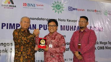 Bank DKI melalui Unit Usaha Syariah melakukan penandatanganan nota kesepahaman penggunaan jasa layanan dan produk perbankan syariah kepada PP Muhammadiyah.Dok Bank DKI