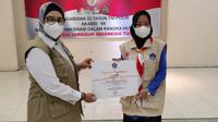 Pada Kamis, 14 Oktober 2021, BNPB melalui Satgas Prokes PON XX Papua memberikan penghargaan kepada 445 relawan protokol kesehatan (prokes) yang mendukung program penguatan prokes selama PON  berlangsung dari 2-15 Oktober 2021. (Dok BNPB)