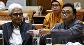 Kepala Badan Tenaga Nuklir Nasional (Batan), Anhar Riza Antariksawan (kanan) mengikuti Rapat Dengar Pendapat (RDP) dengan Komisi VII DPR di Kompleks Parlemen, Jakarta, Kamis (20/2/2020). Rapat membahas temuan radiasi radioaktif di Perumahan Batan Indah, Tangerang Selatan. (Liputan6.com/Johan Tallo)