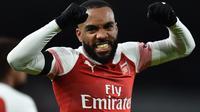 Striker Arsenal merayakan gol ke gawang Fulham pada laga Liga Inggris di Emirates Stadium, Selasa (1/1/2019). (AFP/Glyn Kirk)