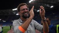 Pelatih Jurgen Klopp tersenyum bahagia usai Liverpool melaju ke final Liga Champions. (Paul ELLIS / AFP)