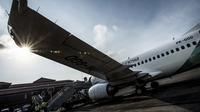 Pesawat Garuda Indonesia disiapkan di Bandara I Gusti Ngurah Rai, Denpasar, Bali, Jumat (24/10/2014), untuk penerbangan perdananya dengan tujuan Dili, Timor Leste. (Antara Foto/Rosa Panggabean)
