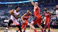 Aksi DeMar DeRozan saat Raptors kalahkan Wizards di gim kelima play-off NBA (AP)