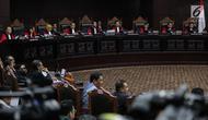 Suasana saat Ketua Kuasa Hukum KPU untuk Pilpres, Ali Nurdin memberikan keterangan dalam sidang sengketa Pilpres 2019 di Gedung MK, Jakarta, Selasa (18/6/2019). Sidang tersebut beragendakan mendengarkan jawaban dari termohon.(Www.sulawesita.com)
