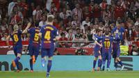 Barcelona menjuarai Copa del Rey 2017-2018 setelah menang 5-0 atas Sevilla pada partai final, Minggu (22/4/2018) dini hari WIB. (AP Photo/Paul White)