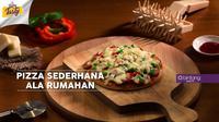 Suka makan pizza? Jangan beli, bikin sendiri aja di rumah. Ini Bintang Tasty kasih resep mudahnya. (Foto: Bintang.com/Daniel Kampua, Digital Imaging: Bintang.com/Muhammad Iqbal Nurfajri)