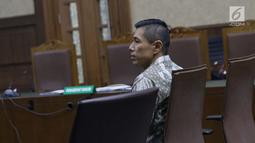 Pimpinan Tjokro Group, Kurniawan Eddy Tjokro saat menjalani sidang perdana kasus dugaan suap kepada Direktur PT Krakatau Steel, Wisnu Kuncoro di Pengadilan Tipikor, Jakarta, Rabu (12/6/2019). Sidang beragendakan mendengar pembacaan dakwaan dari JPU KPK. (Liputan6.com/Helmi Fithriansyah)