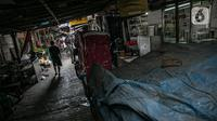 Suasana Gang Gloria, Pancoran, Glodok, Jakarta, Rabu (2/2/2021). Gang yang dipenuhi penjual kuliner khas pecinan yang sudah ada sejak tahun 1920-an ini semakin sepi pembeli karena adanya pandemi Covid-19. (Liputan6.com/Faizal Fanani)