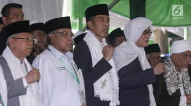 Presiden Joko Widodo menghadiri pembukaan musyawarah nasional dan konferensi besar NU di Banjar, Jawa Barat, Rabu (27/2). Jokowi mengucapkan terima kasihnya atas peran PBNU yang telah berkontribusi dalam merawat keutuhan NKRI. (Liputan6.com/Angga Yuniar)