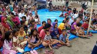 Warga korban gempa Lombok di pengungsian mengikuti HUT ke-73 RI (Liputan6.com/Sunariyah)