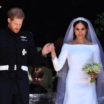 Pangeran Harry dan Meghan Markle saat resmi mengikat janji suci pernikahan. (Ben STANSALL / AFP)