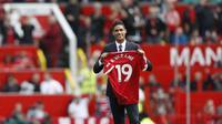 Manajer Manchester United, Ole Gunnar Solskjaer, menyambut antusias kedatangan Raphael Varane sebagai rekrutan anyar pada musim panas ini. (AFP/Adrian Dennis)