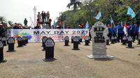 Suasana peringatan Hari Buruh di Patung Kuda Jakarta, Sabtu (1/5/2021). (Liputan6.com/Ady Anugrahadi)