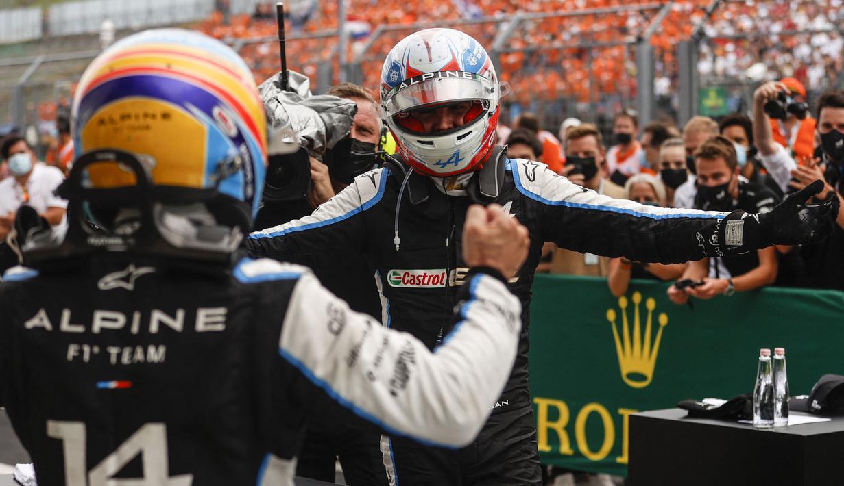 Esteban Ocon dari tim Alpine F1-Renault akhirnya memenangi Grand Prix ke-11 yang berlangsung di Sirkuit Hongaroring. Balapan penuh drama tersaji dalam perlombaan yang menempuh 70 lap tersebut. (Foto: AFP/Pool/Florion Goga)