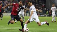 AC Milan harus puas bermain 1-1 kontra Cagliari pada laga pekan keempat Serie A, di Sardegna Arena, Minggu (16/9/2018) waktu setempat. (Fabio Murru/ANSA via AP)