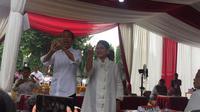 Presiden Jokowi dan Ibu Iriana usai mencoblos di TPS.