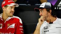 Sebastian Vettel (kiri) dan Fernando Alonso, dianggap sebagai pebalap terbaik di grid F1 saat ini. (GPUpdate/Sutton Images)