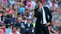 Pelatih Luis Enrique sukses membawa Barcelona juara La Liga Spanyol di musim pertamanya (CESAR MANSO / AFP)