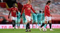 Gelandang Manchester United, Donny van de Beek, ketika melawan Liverpool di Piala FA, Senin (25/1/2021). (AFP/LAURENCE GRIFFITHS).