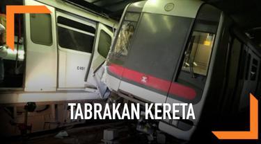 Tabrakan terjadi antara dua kereta MTR saat uji coba sistem sinyal baru di Hong Kong. Akibatnya dua masinis terluka.