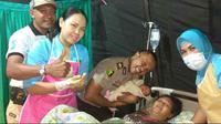 Ibu hamil korban gempa Lombok terpaksa melahirkakn di tenda darurat Rumah Sakit Bhayangkara Polda Nusa Tenggara Barat atau NTB, Ma...