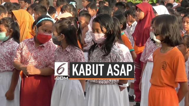 Suasana pagi kota Palangka Raya diselimuti kabut asap kebakaran hutan. Aktivitas di sejumlah tempat mulai terganggu, karena asap iritasi mata dan berdampak buruk bagi pernafasan warga