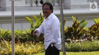 Menteri Agraria dan Tata Ruang Sofyan Djalil tiba di Istana, Jakarta, Selasa (22/10/2019). Sofyan melempar senyum kepada media jelang wawancara calon menteri Kabinet Kerja Jilid II bersama Presiden Joko Widodo. (Liputan6.com/Angga Yuniar)
