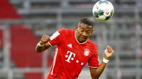 David Alaba - Jebolan akademi Bayern Munchen ini sukses mempersembahkan treble sebanyak dua kali untuk Die Roten. Pemain berkebangsaan Austria itu menjadi andalan sekaligus kunci di sektor kiri lini pertahanan. (AFP/Pool/Kai Pfaffenceach)