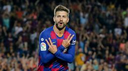 1. Gerard Pique (33 tahun) - Gerard Pique menjadi pemain paling tua di skuad utama Barcelona pada musim ini. Pemain asal Spanyol ini telah menginjak usia 33 tahun. (AFP/Pau Barrena)