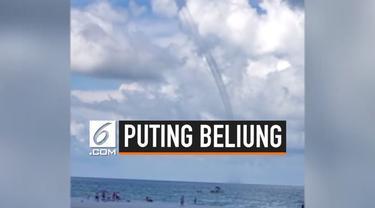 Beredar video puting beliung raksasa di Pulau Siesta Key, Florida. Fenomena alam ini menjadi tontonan warga yang ada di sekitar.