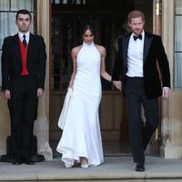 Patung lilin Meghan Markle dan Pangeran Harry akhirnya dibuat oleh Madame Tussauds. (STEVE PARSONS  POOL  AFP)