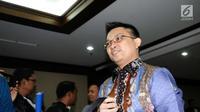 Tersangka dugaan suap terhadap Ketua Pengadilan Tinggi Manado Sudiwardono, Aditya Anugrah Moha bersiap meninggalkan ruang sidang Pengadilan Tipikor, Jakarta, Rabu (28/2). Sidang mendengar pembacaan dakwaan JPU. (Liputan6.com/Helmi Fithriansyah)