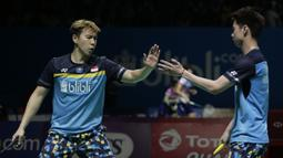 Ganda putra Indonesia, Marcus Gideon / Kevin Sanjaya, berhasil mengalahkan Ou Xuan Yi / Zhang Nan pada Indonesia Open 2019 di Istora Senayan, Jumat (19/7). Marcus / Kevin menang 21-12 dan 21-16. (Bola.com/Yoppy Renato)