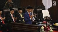 Presiden Joko Widodo atau Jokowi menyampaikan Pidato Kenegaraan pada Sidang Tahunan MPR 2019 di Kompleks Parlemen, Senayan, Jakarta, Jumat (16/8/2019). Jokowi akan menyampaikan pidato dalam tiga sesi dengan tema yang berbeda selama acara berlangsung. (Liputan6.com/Johan Tallo)