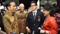 Hadiri Wisuda anak, Jokowi dan Iriana kenakan pakaian khas Indonesia (Foto: http://www.straitstimes.com/)