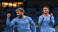 Striker Manchester City, Sergio Aguero, mencetak gol ke gawang Marseille dalam laga terakhir Grup C Liga Champions, Kamis (10/12/2020) dini hari WIB. Manchester City menang telak 3-0 dalam pertandingan ini. (Paul ELLIS / AFP)