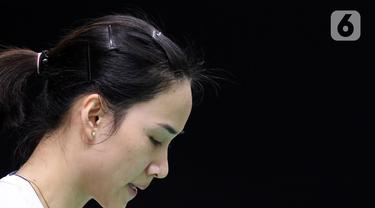 Pebulutangkis tunggal putri Thailand, Nitchaon Jindapol saat melawan Carolina Marin (Spanyol) pada babak pertama Indonesia Masters 2020 di Istora GBK, Jakarta, Rabu (15/1/2020). Nitchaon Jindapol kalah 13-21, 15-21. (Liputan6.com/Helmi Fithriansyah)