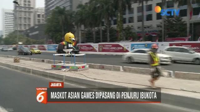 Maskot Asian Games, Bhin-bhin, Atung, dan Kaka, mulai menghiasai ruas jalanan Ibukota.