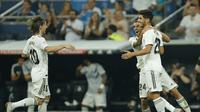 Real Madrid mengalahkan Espanyol berkat gol tunggal Marco Asensio.  (AP Photo/Paul White)