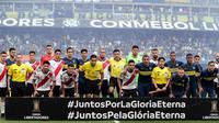 Boca Juniors dan River Plate saling berhadapan pada laga final Copa Libertadores 2019. (AFP/ALEJANDRO PAGNI)