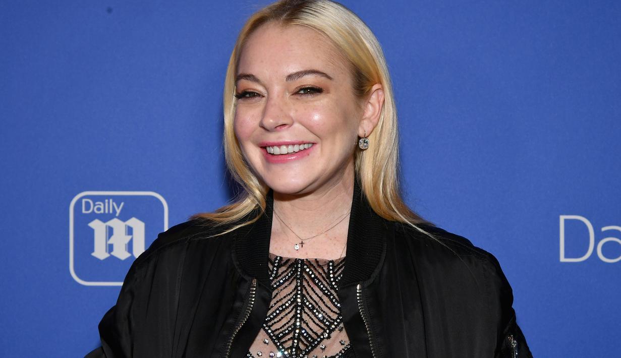 Lindsay Lohan mengungkapkan bahwa kakinya baru saja digigit ular saat liburan di Thailand. (SLAVEN VLASIC  GETTY IMAGES NORTH AMERICA  AFP)