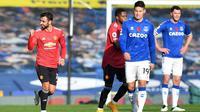 Gelandang Manchester United, Bruno Fernandes, melakukan selebrasi usai mencetak gol ke gawang Everton. (AFP/Paul Elis)
